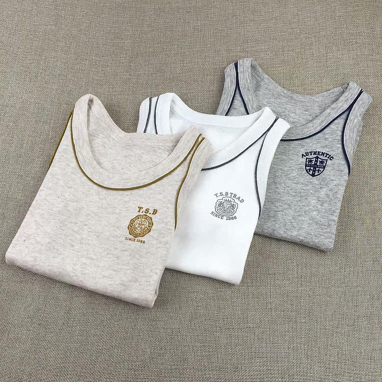 Color classification: Grey/white/light brown 3 piece vest