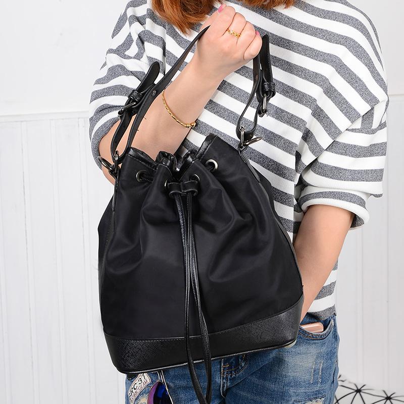 韩版潮帆布包女水桶包尼龙