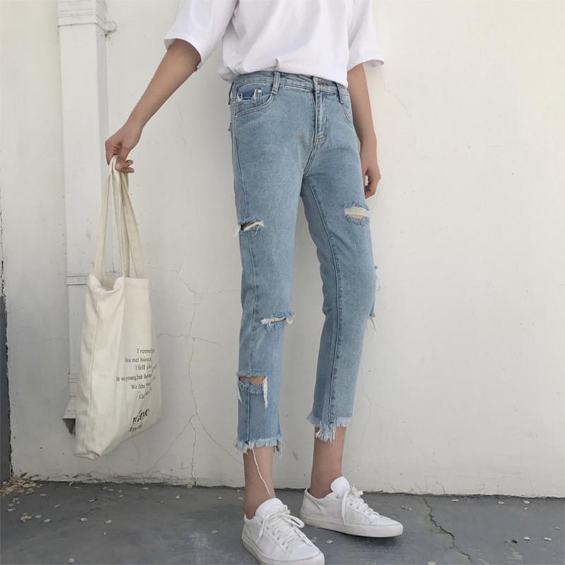 早秋新款女装韩版复古不规则破洞毛边牛仔裤女高腰显瘦九分小脚裤