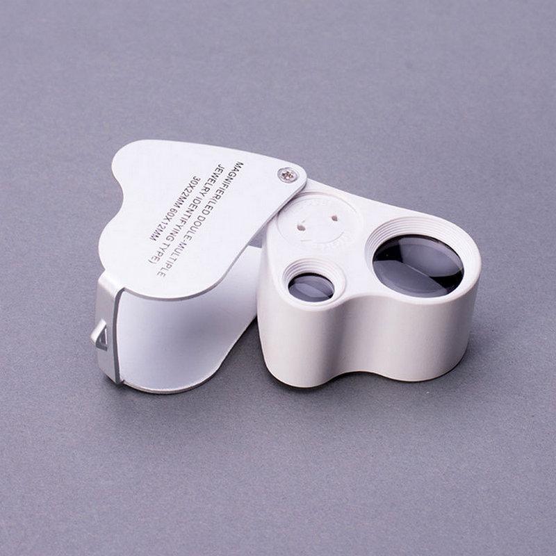 Más de 60 veces con luces LED de alta potencia de mini - lupa de bolsillo de clara expansión portátil de joyas de evaluación es una lupa v300