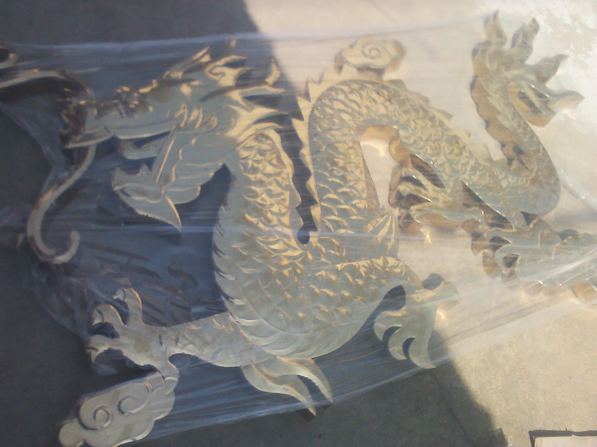 Spherical titanium titanium gold dragon head word Laofengxiang process