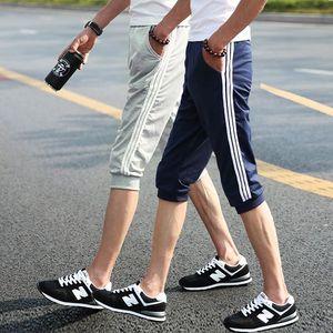 7 điểm quần của nam giới mùa hè quần short thể thao nam mùa hè hậu cung quần âu chàng trai quần người đàn ông lỏng lẻo của cắt quần