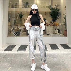 Hong Kong-phong cách retro chic slim treo cổ chữ thập eo vest top + cao eo đa năng quần chân phù hợp với phụ nữ