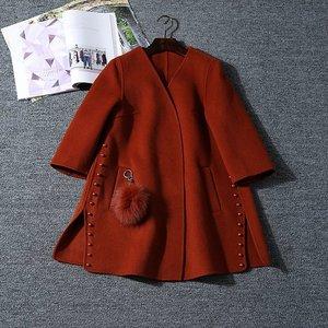 Mùa thu trang trí ngọc trai mới hai mặt áo len lông Jiao Jiao
